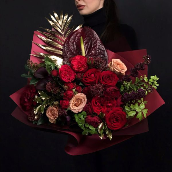A beautiful bouquet created with large and spray Roses, black Calla Lilly, Anthurium, Skimmia and Callicarpa.