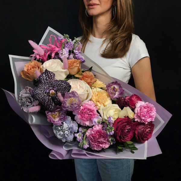 A beautiful bouquet made with cut stems of Orchid, Roses in a variety of colors and sizes, Dianthus and Tulips, Lagurus, Matthiola and hot pink Nerine. Enjoy!