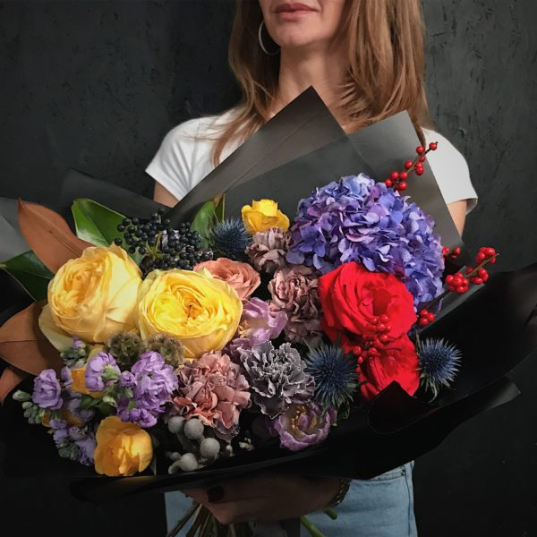 This bouquet is created with of mix of Roses in different colors and sizes, huge blue Hydrangea, Dianthus, Matthiola, Tulips, Magnolia leaves, Ilix and Blackberry, Eryngium.