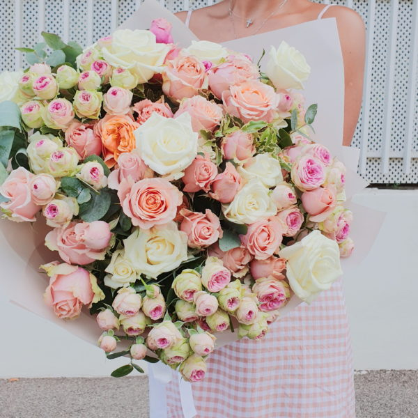 This bouquet is a mix of Roses and Spray Roses wrapped in light rose paper.