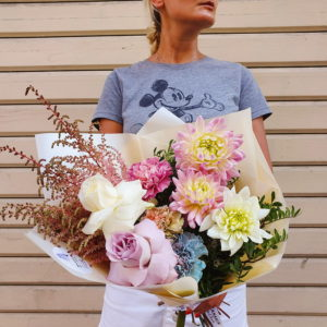 A delicate bouquet created with white and lila Roses, Dianthus and Dhalia and peach Astilbes.
